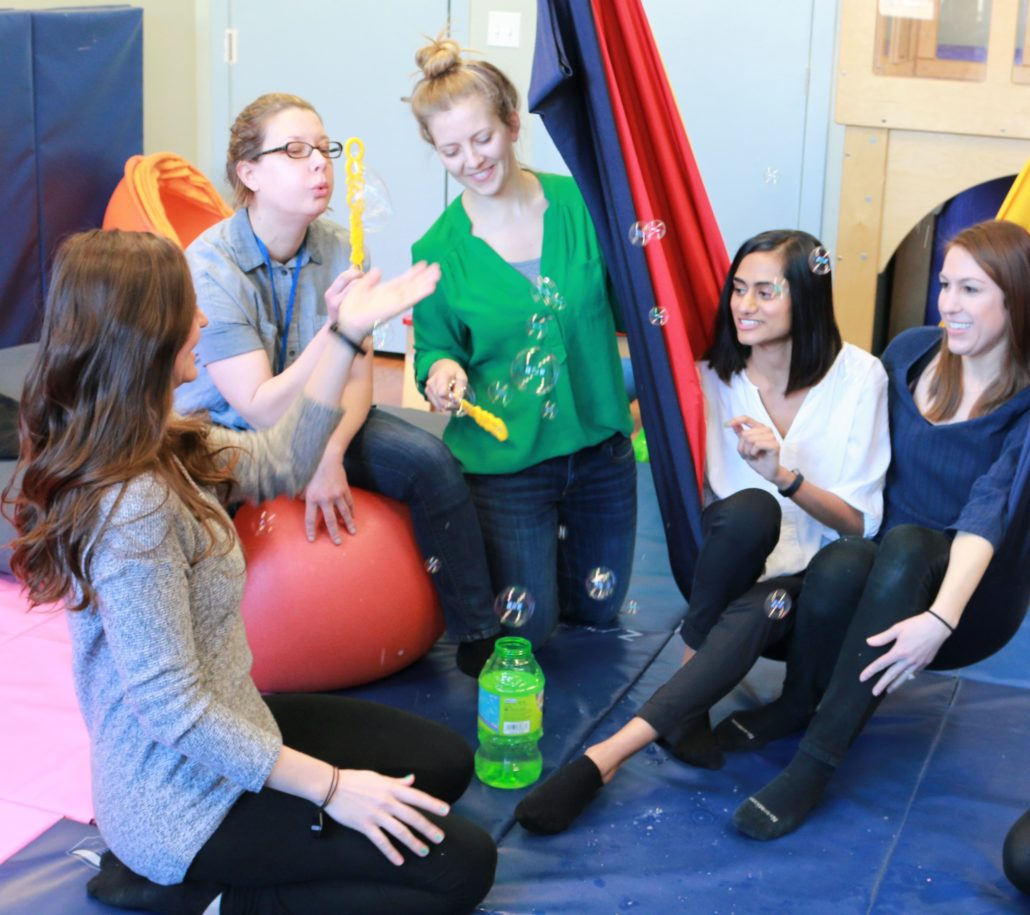 Occupational therapists on therapeutic swing