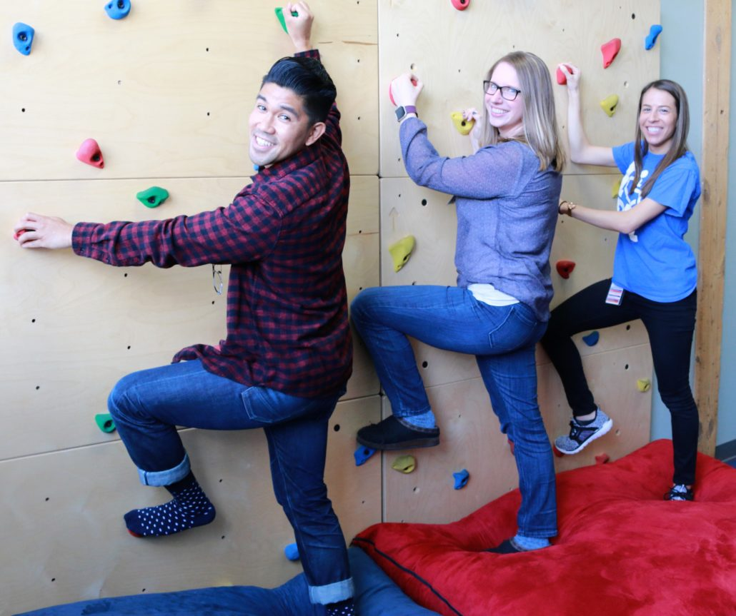 Therapists on rock wall