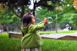 Blue Bird Day and girl bubbles