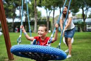 Blue Bird Day and boy on swing