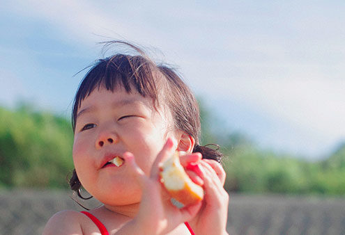 Blue Bird Day and child eating bread image