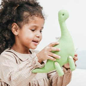Blue Bird Day and toy dinosaur