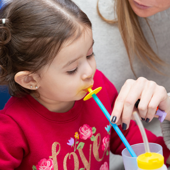 Strengthening Mealtime - girl drinks from straw